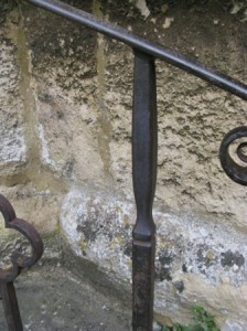 Original wrought iron upright at St Cyriacs Church Lacock